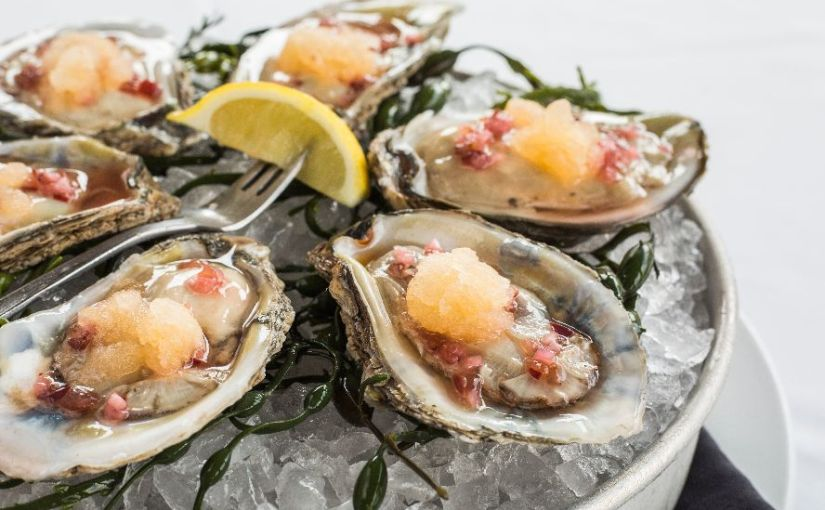 Oysters are 1/2 off at happy hour as Ocean Prime re-opens