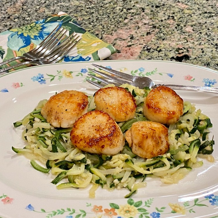 Scallops and zucchini noodles photo