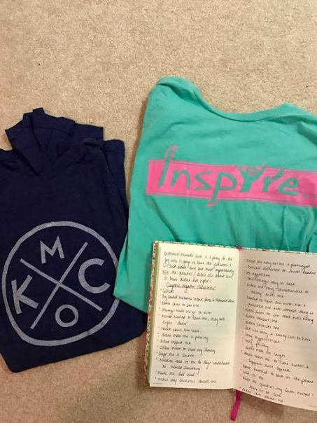 A collection of the Jennings' Christian t-shirts (they are also the brand he sells) she took home from his house, along with her journal, in which she kept detailed notes.