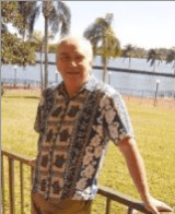 Author Fred Zackel in Hawaiian shirt in front of beach