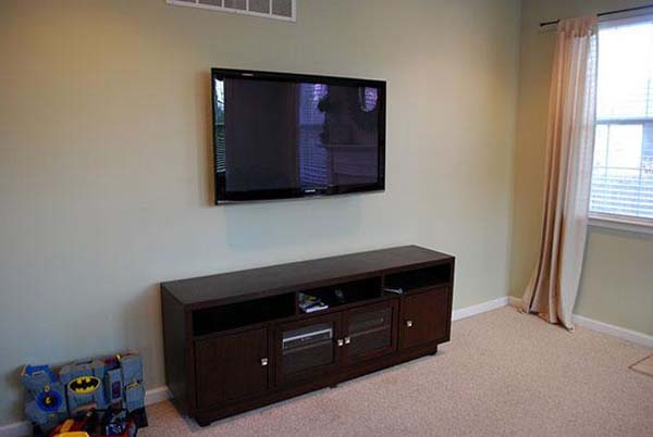 12.) Hang a painting over a TV when it's not in use.