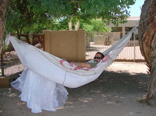 He didn't think the dress-hammock would support his weight, but voila: one of the best uses for the dress yet.
