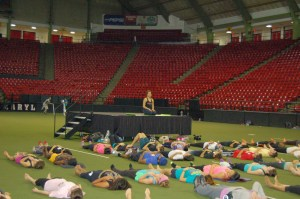 Students relax after the Yoga World Record event, Tuesday, Oct. 14, 2014, in Cole Field House.