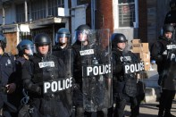 Police stand guard in downtown Baltimore, MD. April 28, 2015