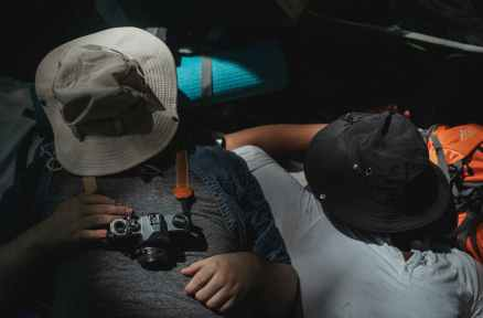 tired faceless men sleeping in camp tent