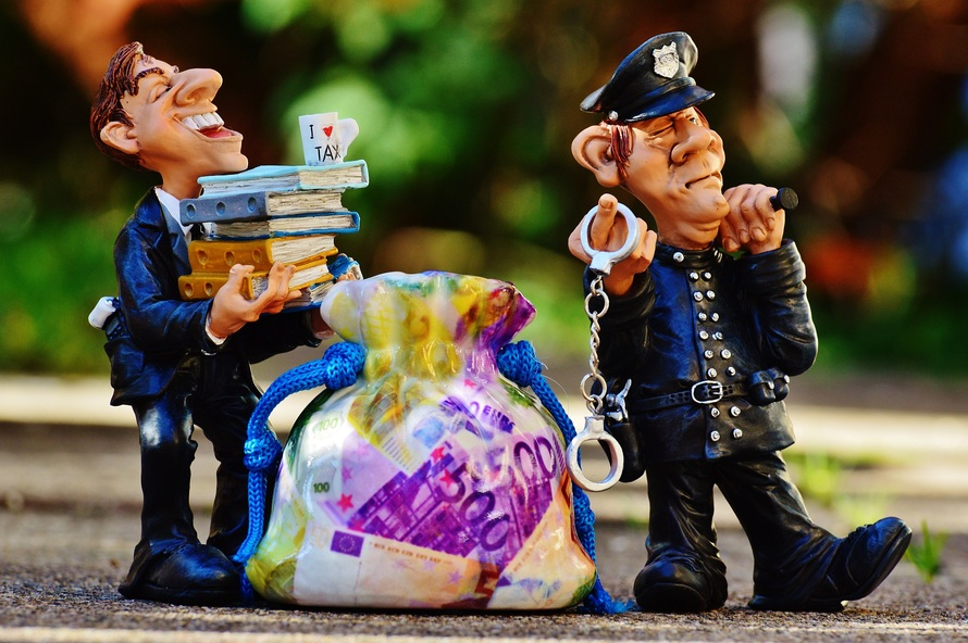 taxes-tax-evasion-police-handcuffs-large
