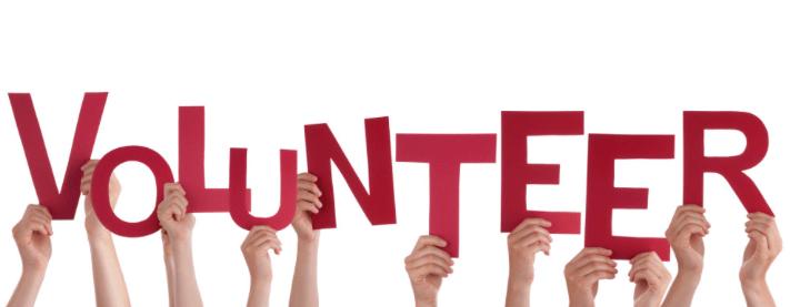 Hands Holding Volunteer Sign