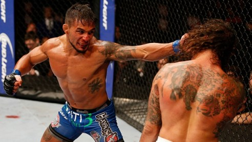 SAN JOSE, CA - JULY 26: (L-R) Dennis Bermudez punches Clay Guida in their featherweight bout during the UFC Fight Night event at SAP Center on July 26, 2014 in San Jose, California. (Photo by Josh Hedges/Zuffa LLC/Zuffa LLC via Getty Images)