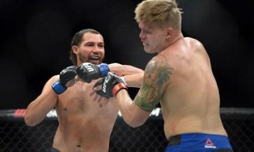 Aug 6, 2016; Salt Lake City, UT, USA; Chase Sherman (red gloves) and Justin Ledet (blue gloves) fight during UFC Fight Night at Vivint Smart Home Arena. Ledet won via unanimous decision. Mandatory Credit: Joe Camporeale-USA TODAY Sports