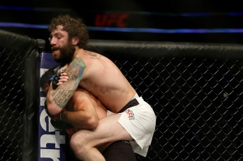 Apr 16, 2016; Tampa, FL, USA; Michael Chiesa (blue gloves) reacts after defeating Beneil Dariush (red gloves) in the lightweight bout (bout 7) during UFC Fight Night at Amalie Arena. Chiesa won. Mandatory Credit: Reinhold Matay-USA TODAY Sports