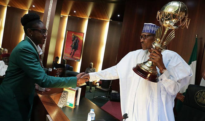 Image result for Buhari showers cash gifts on D'Tigress players, officials