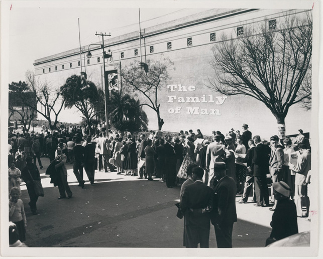 Visitors await entry to The Family of Man, an exhibition organized by The Museum of Modern Art, at the Government Pavilion, Johannesburg, Union of South Africa (on view August 30–September 13, 1958). From The International Council/International Program Exhibition Records. Image courtesy The Museum of Modern Art