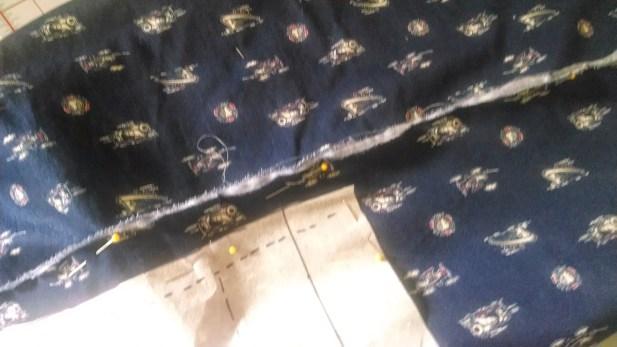 Tearing the fabric helps establish the grain.