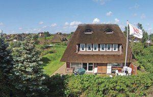 casa con il tetto in paglia