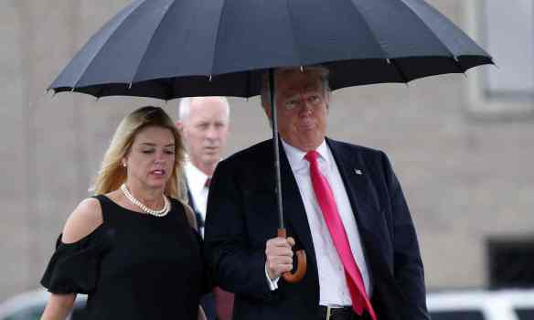 Trump with Florida attorney general Pam Bondi at a campaign rally in August. Photograph: Gerald Herbert/AP