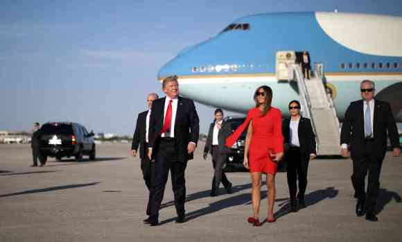 Donald Trump arrives at Palm Beach international airport on 3 February. County aviation officials say the president's four-day visit cost more than $250,000 in lost revenue. Photograph: Carlos Barria/Reuters