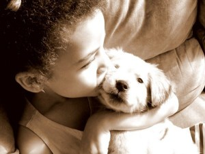 little-girl-kissing-puppy