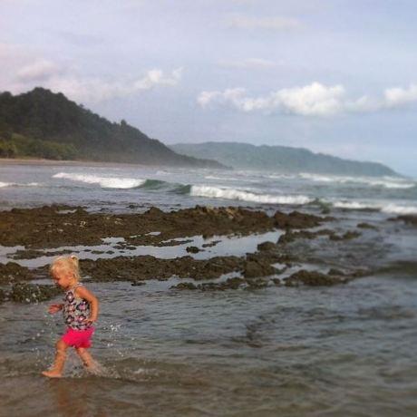 Toddler running on beach