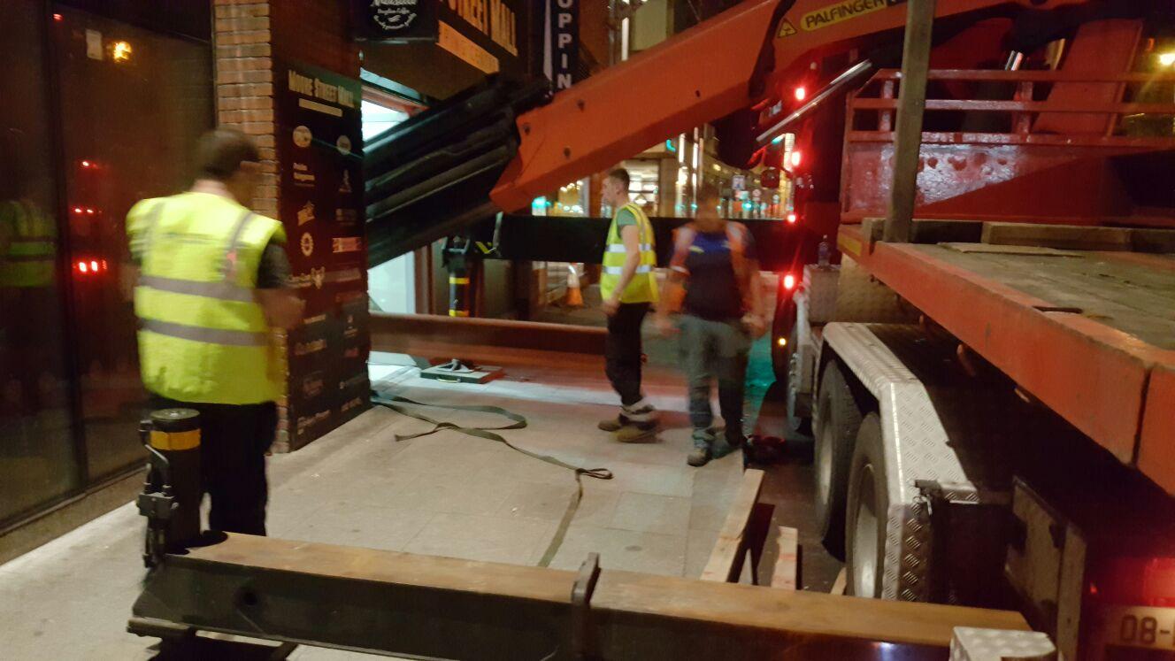 3 - Steel being unloaded from truck in through pedestrian door opening