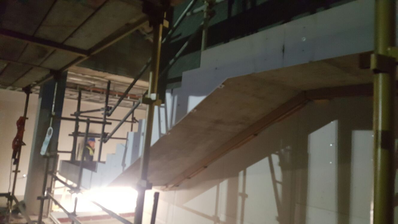 2 - Continuous mild steel stringer added to side of stairs