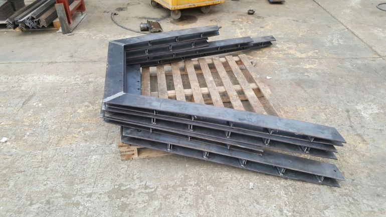 2 - Mild steel stringers and rails in production