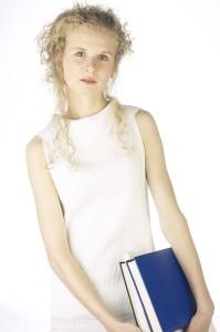 girl holding bluebook