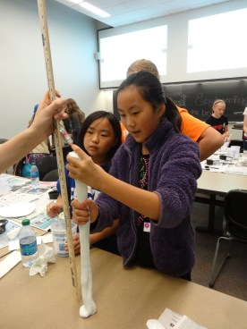 Girl Scouts Measure their Project