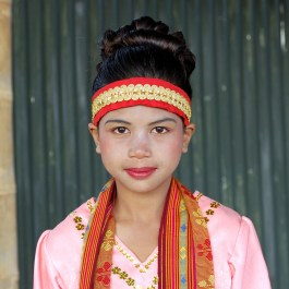 Girl in traditional dress in Ruteng – Pure Flores Tours