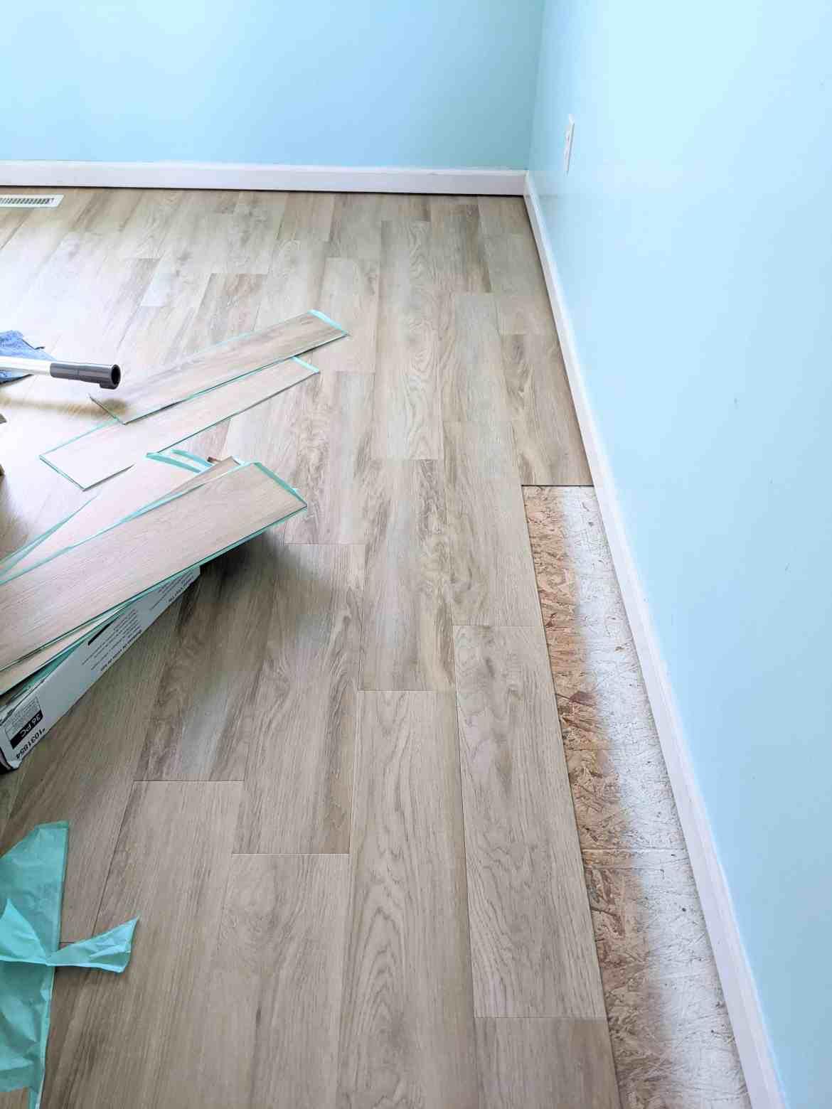 vinyl flooring being laid