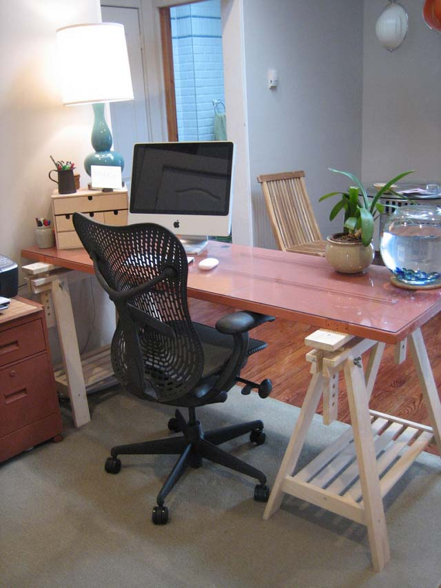 This workspace features a computer desk made of a repurposed door 640_wide