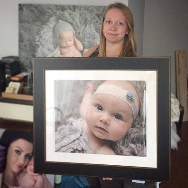 photographer-holding-frame-of-baby-photo