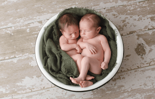 twins-newborn-photographer-ottawa-ceramic-bowl-baby-wrap-olive-textured-wood-backdrop