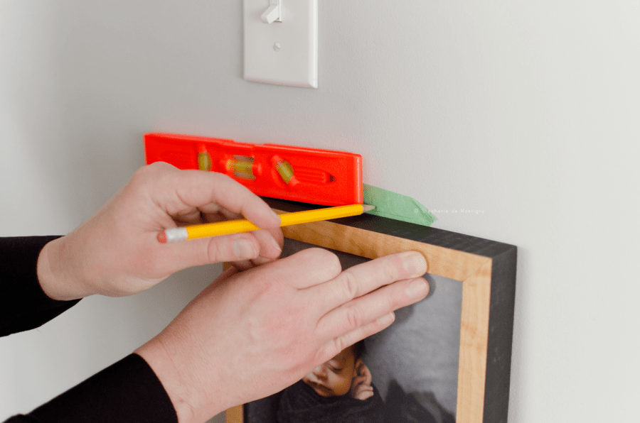 diy tutorial hanging artwork stairwell mark the wall