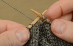 "Slip the first stitch from the ""back"" needle to the right needle."