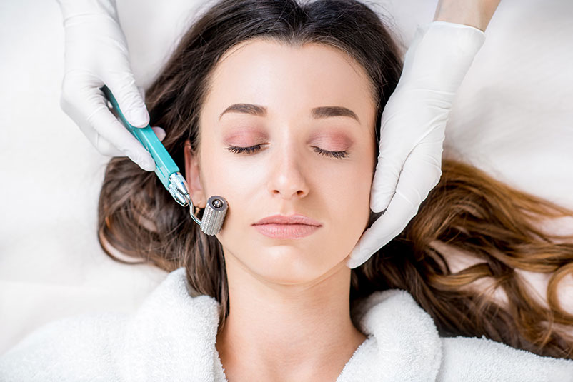 Woman's facial treatment with microneedling