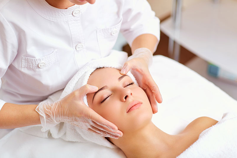 Beautiful woman at a facial massage.