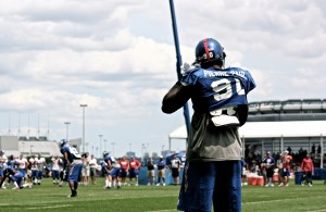 Jason Pierre-Paul straps on the helmet during training camp. Credit: BOBBY O'HARA/PureSportsNY