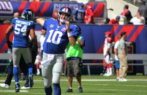 Eli Manning threw for 277 yards on Sunday vs Arizona including 2 touchdowns and 2 interceptions, nut showed signs of improvement. Credit: BOBBY O'HARA/PureSportsNY