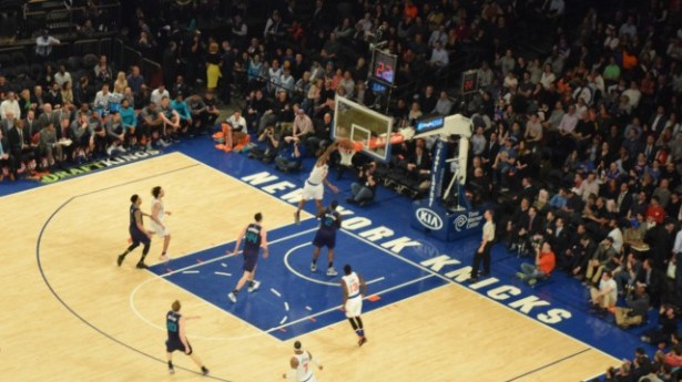 (Photo Credit: Barry Holmes/PureSportsNY) Not even Williams crowd pleasing dunk was enough to fend off the Hornets.