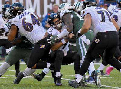 (Photo Credit:AP Photo/Bill Kostroun) The Jets defense put pressure on Flacco all afternoon.