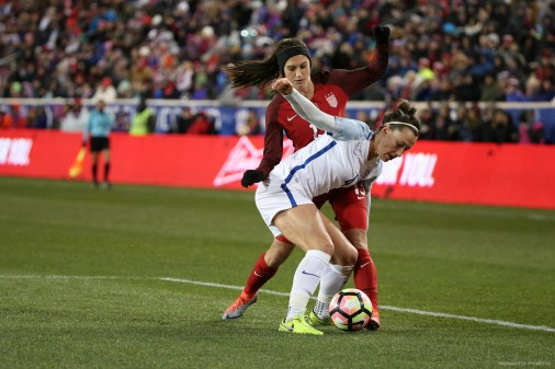 Alex Morgan dribbles through a defender in the first half. Photo (Bobby O'Hara/ PuresportsNY)