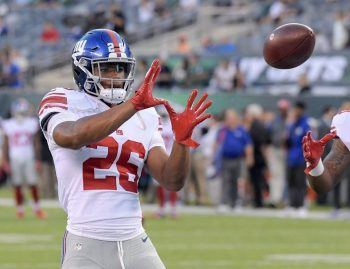 (Photo Credit: Bill Kostroun/AP) Barkley only played a few snaps in the Giants preseason opener.