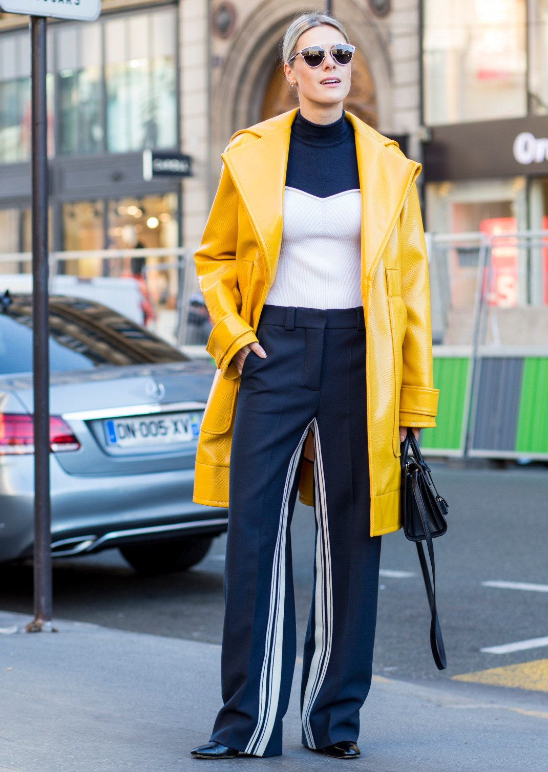 woman wearing navy and yellow
