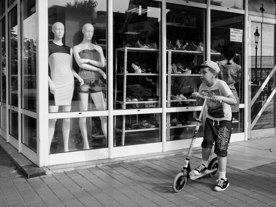 mannequins looking at a boy
