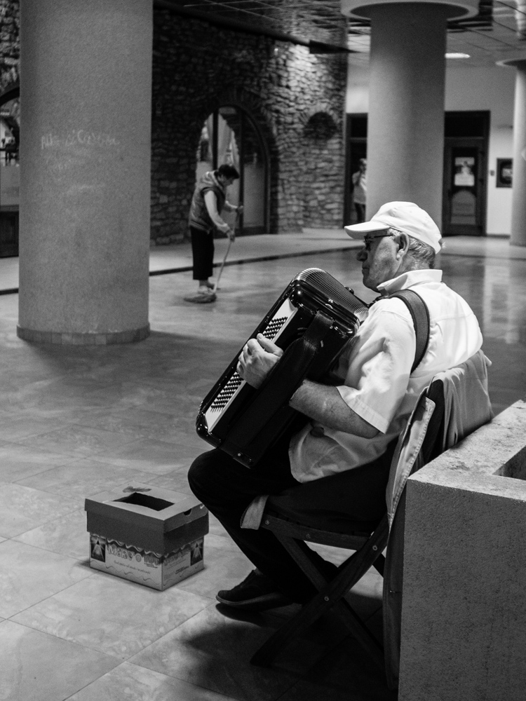 street musician and cleaning lady