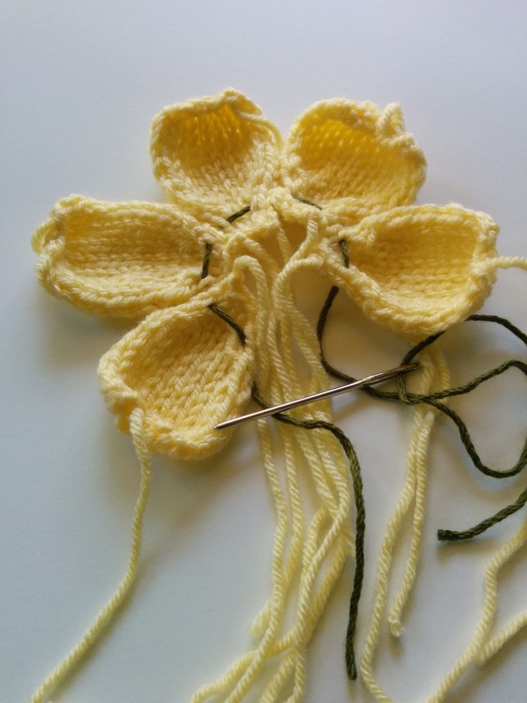 knitted dogwood blossom assembly
