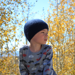 Boy in unisex simple knit beanie, hat knitting pattern in all sizes by Liz @PurlsAndPixels