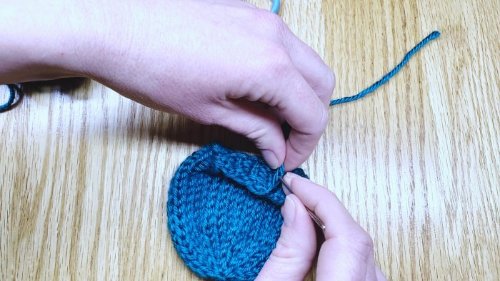 Step 12: Weave in cast on tail for round knitting projects - a lesson with Liz Chandler @PurlsAndPixels.