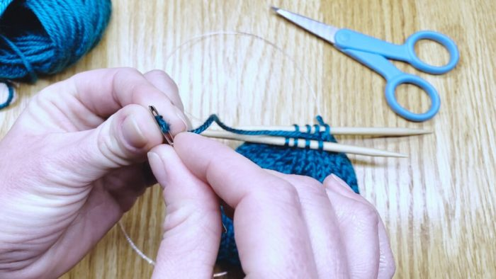 Step 2: Draw yarn through remaining stitches to bind off knits in the round - a lesson with Liz Chandler @PurlsAndPixels.