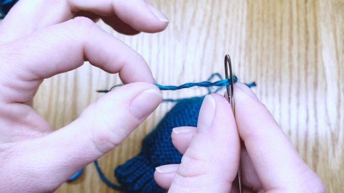 Step 16: Weave in the yarn tail to finish mitten fingertips a knitting lesson with Liz Chandler @PurlsAndPixels.